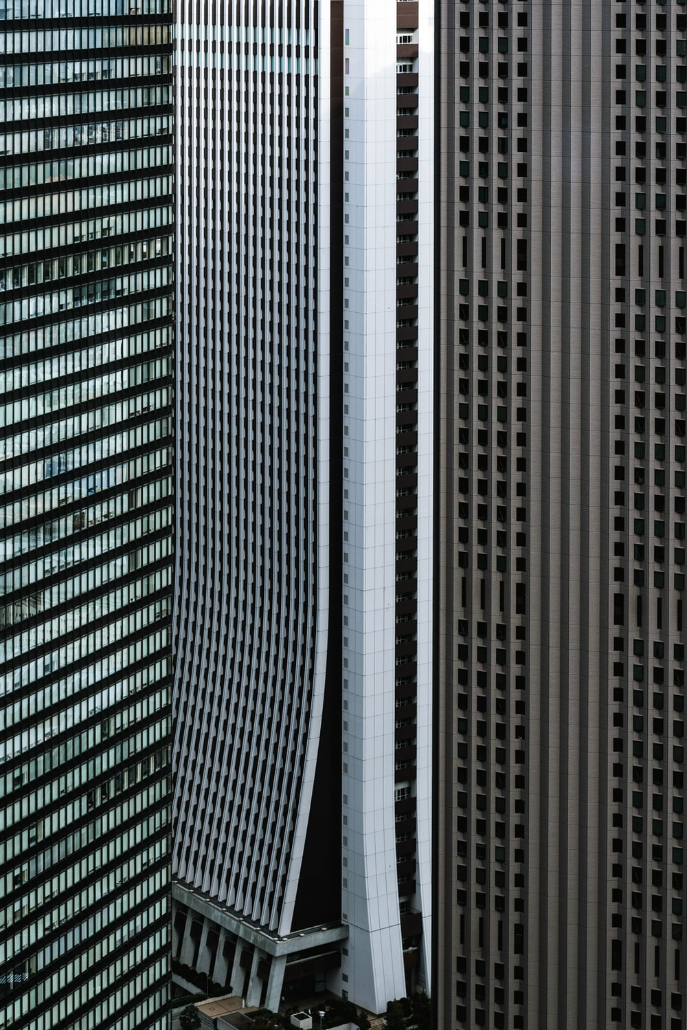 gray, white, and brown high-rise buildings