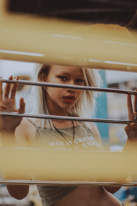 woman leaning on windowpane