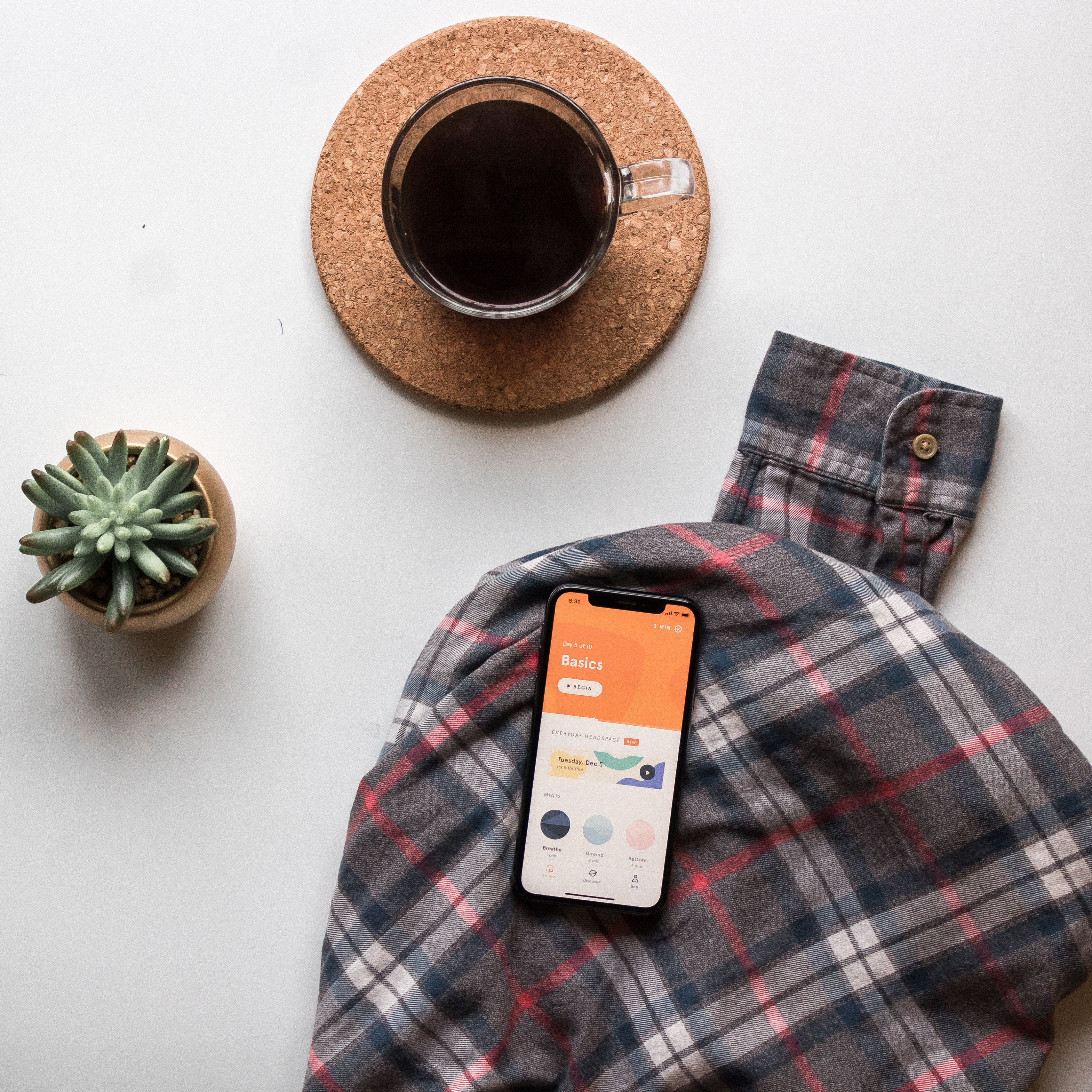 black smartphone on long-sleeved shirt