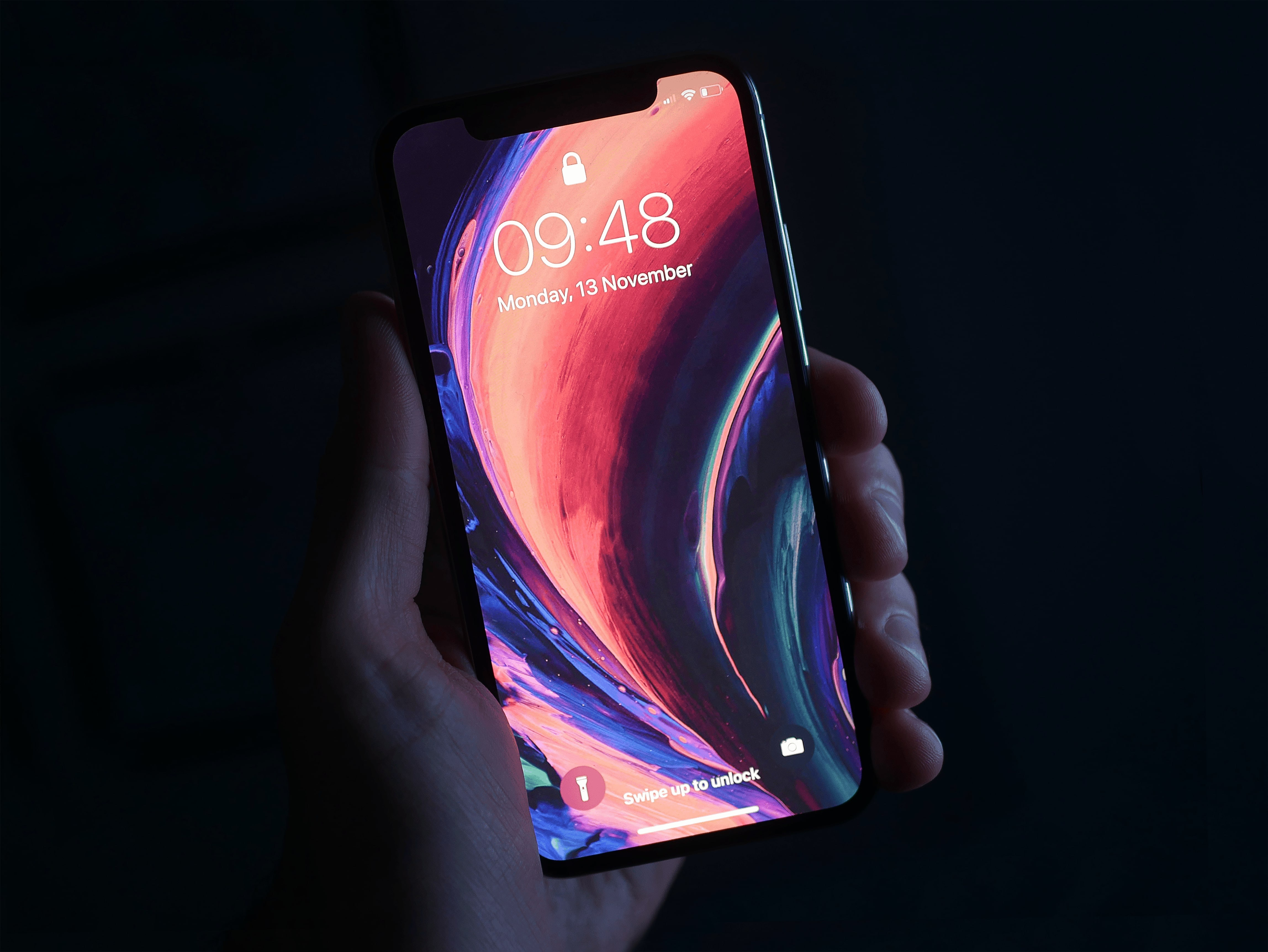 person holding space gray iPhone X