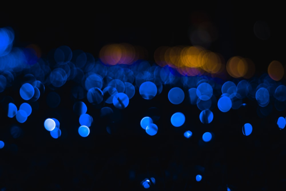 blue and yellow bokeh lights photography