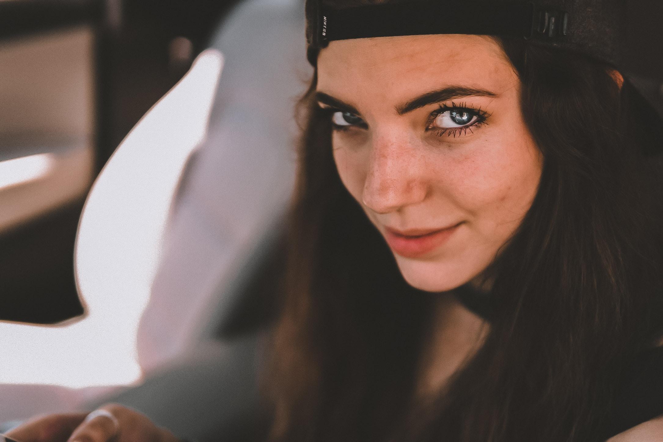 woman wearing cap
