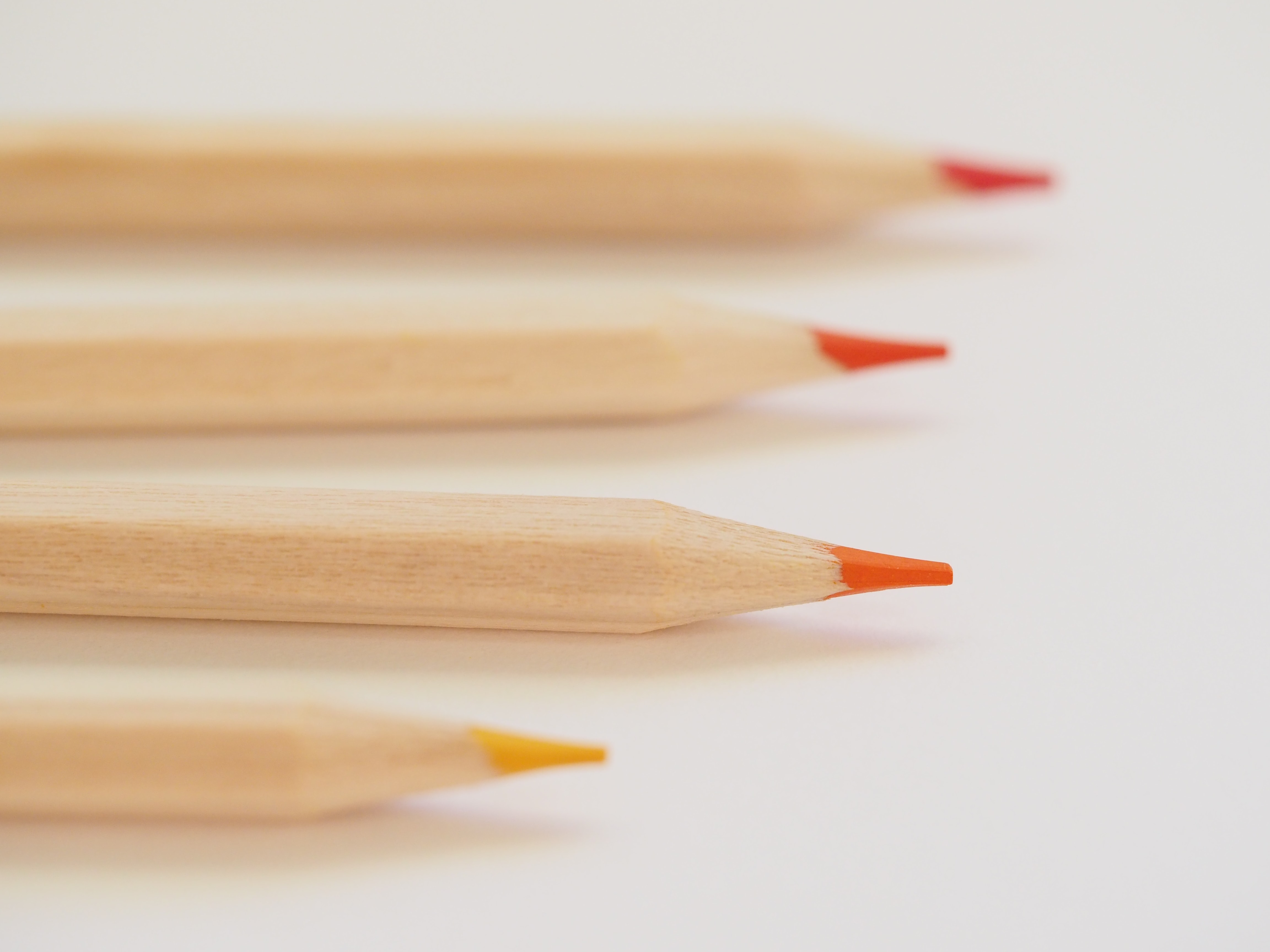 selective focus photo of color pencils