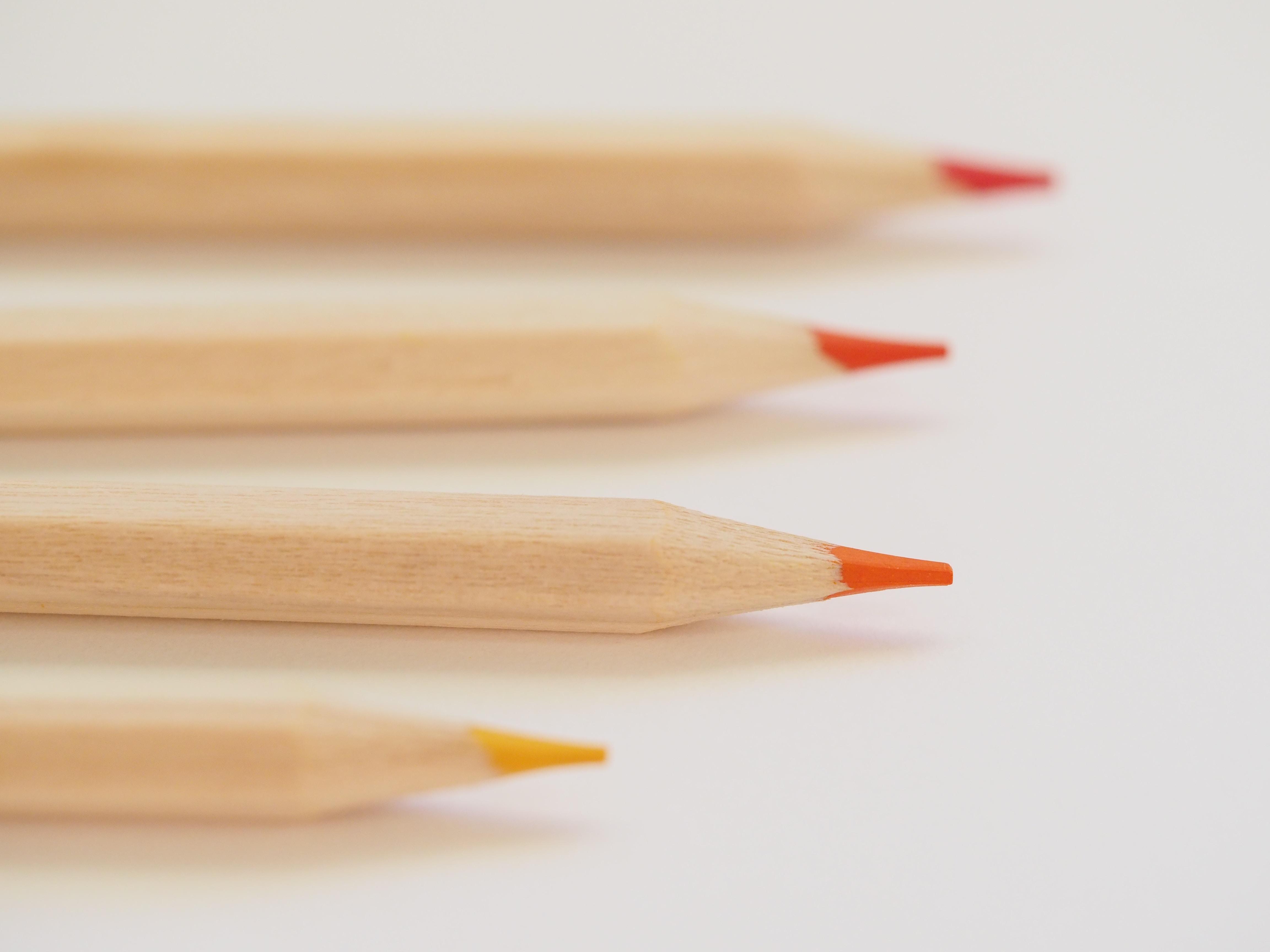selective focus photo of color pencils