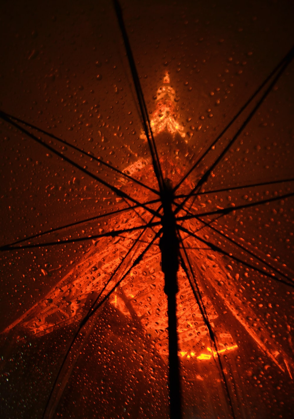 orange umbrella with drops