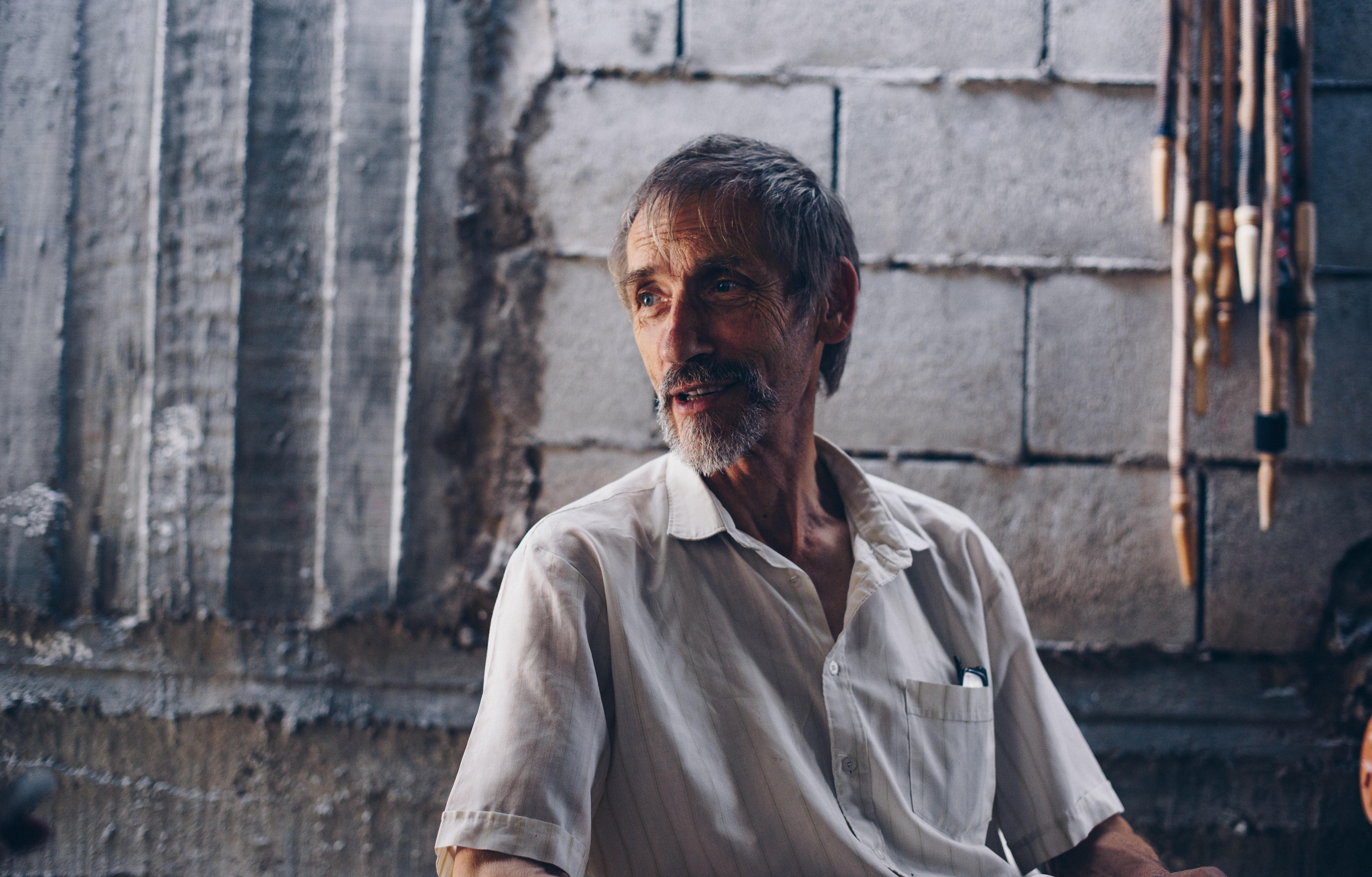 man wearing white button-up shirt
