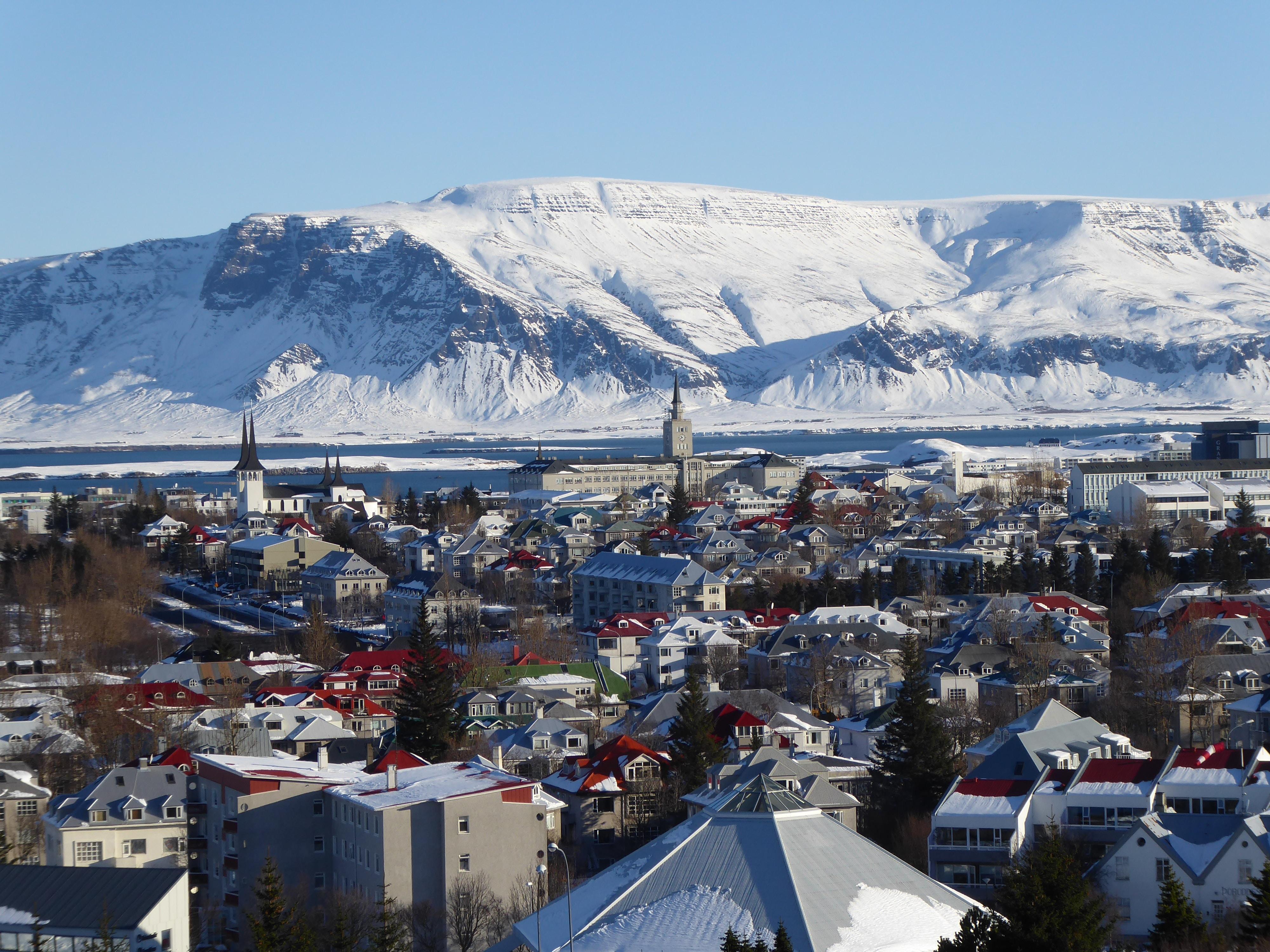bird's eye photography of city near snow mountain