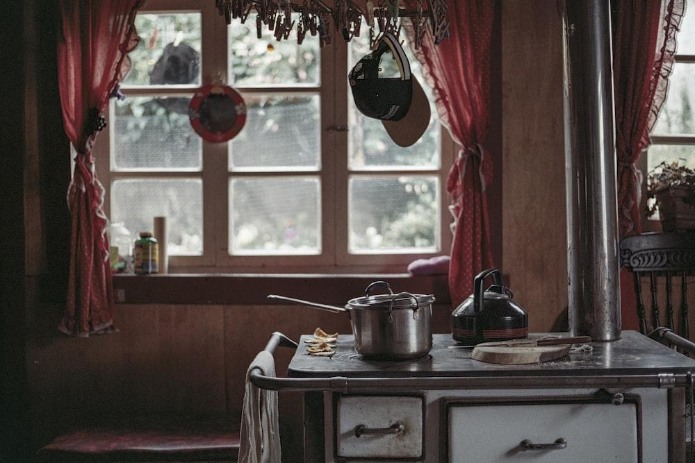 silver pot near window