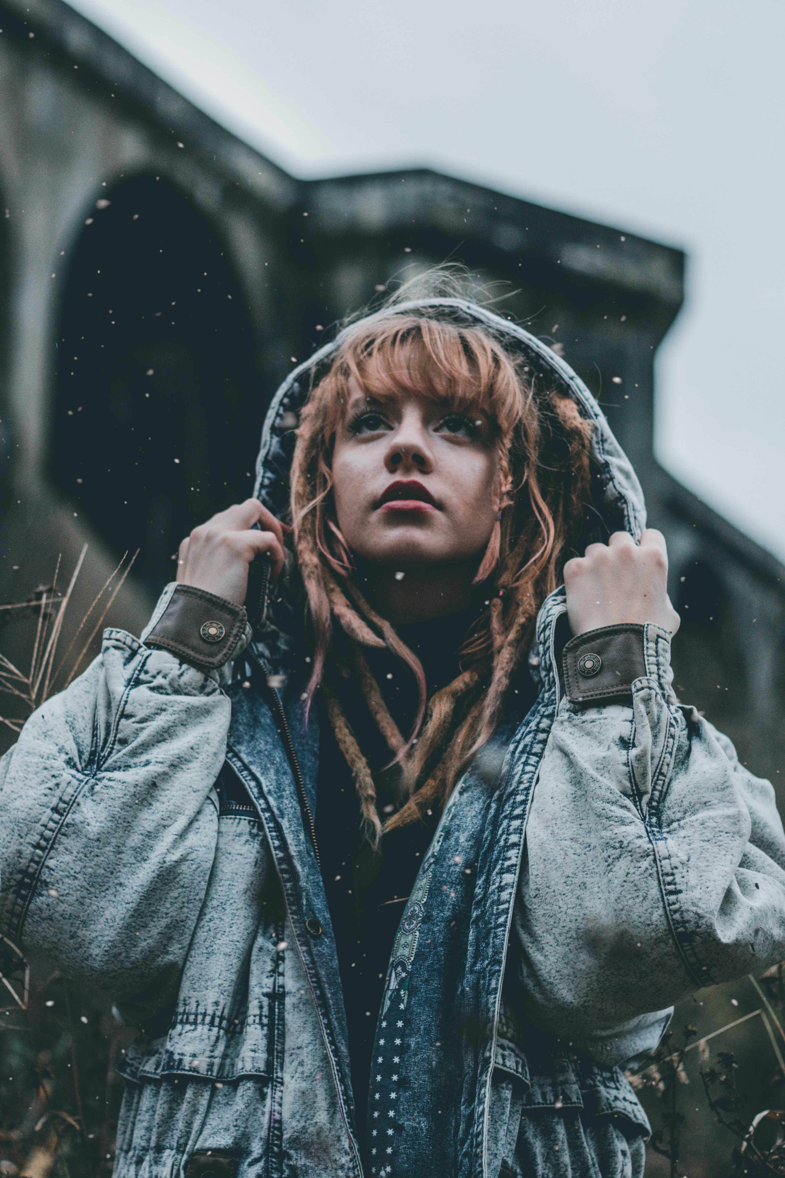 shallow focus photography of woman holding her hoodie