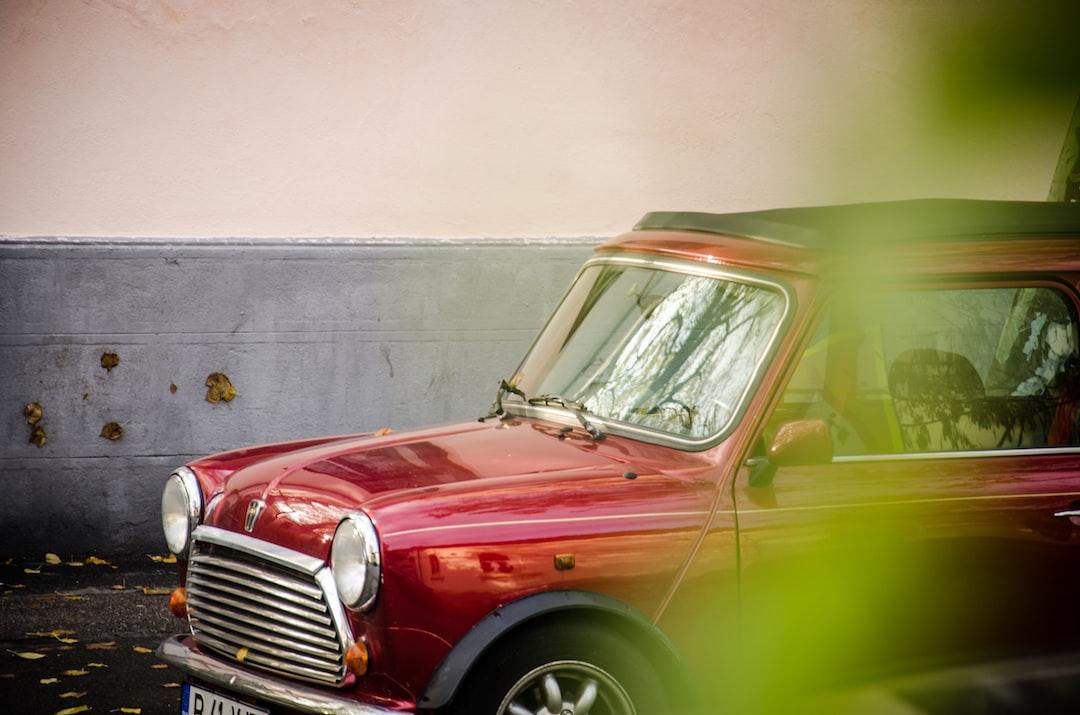 red car near gray wall