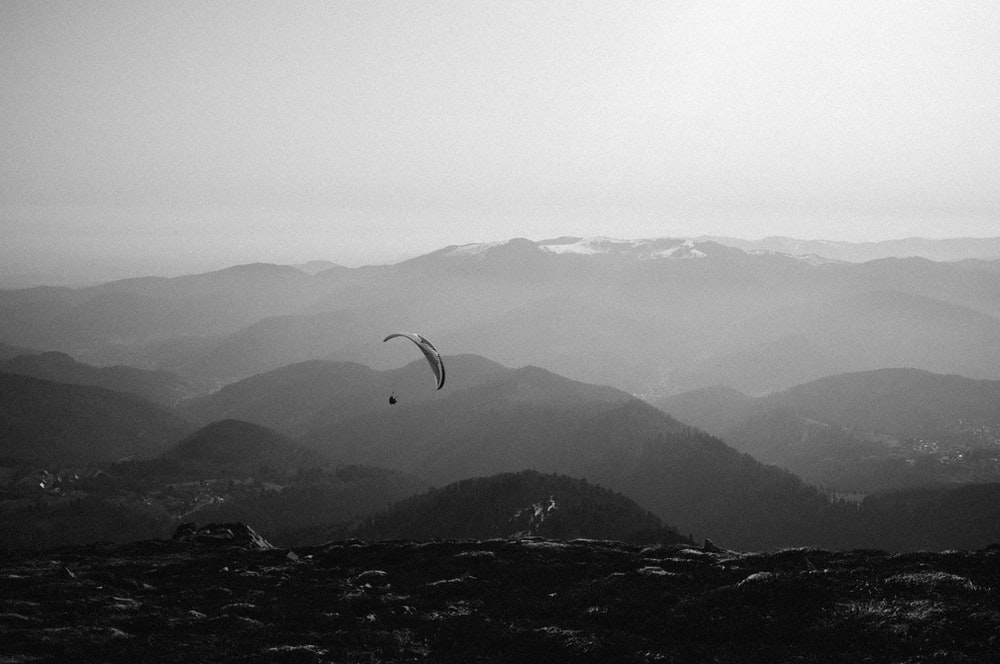 person doing paragliding