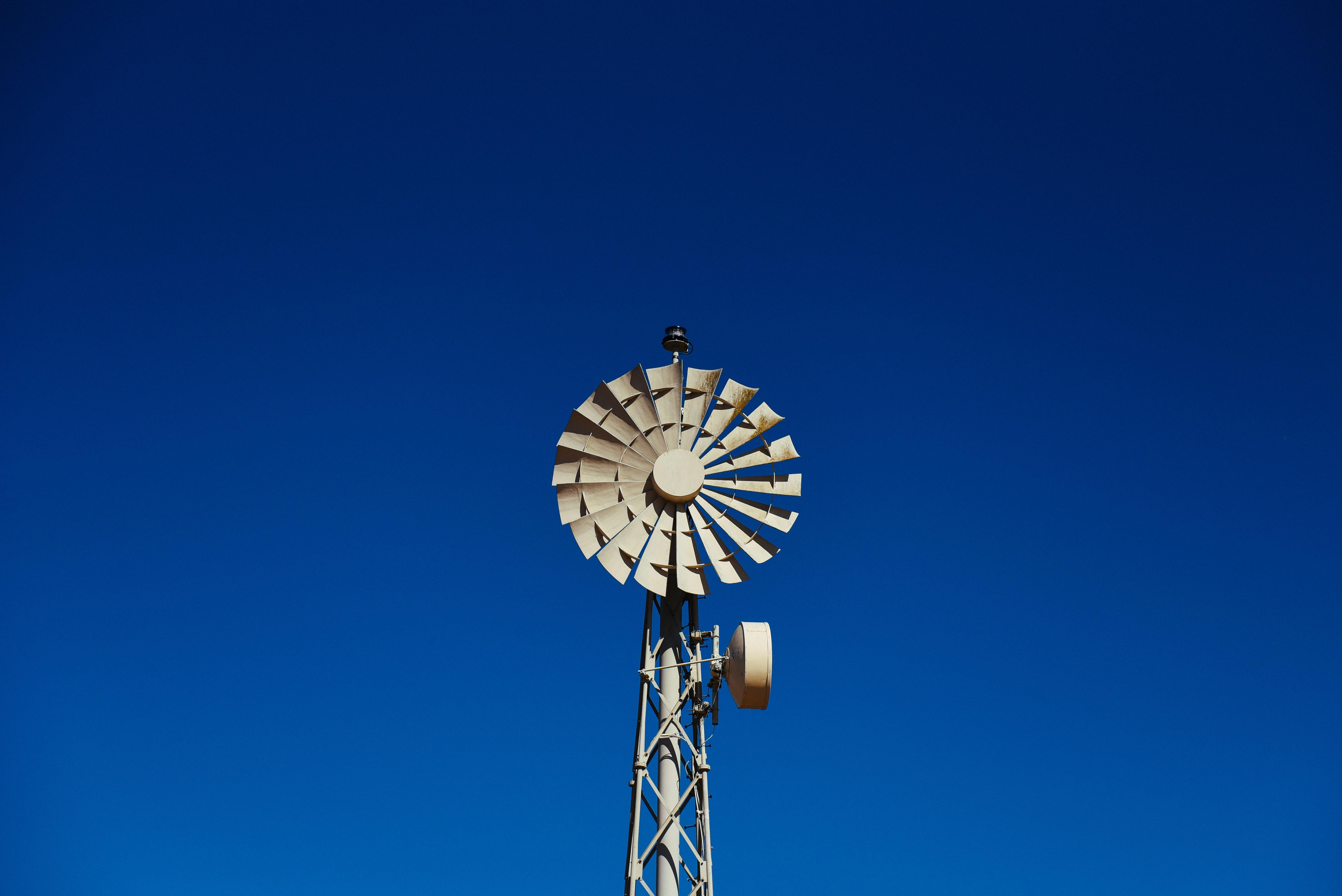 low angle photography beige wind turbine