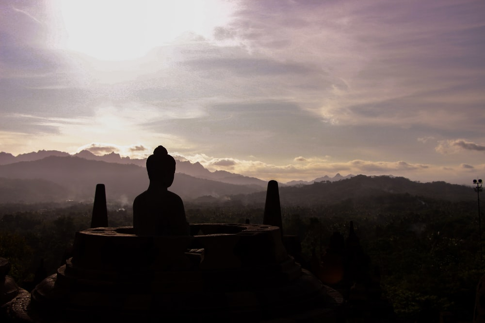 silhouette photography of Buddha monument