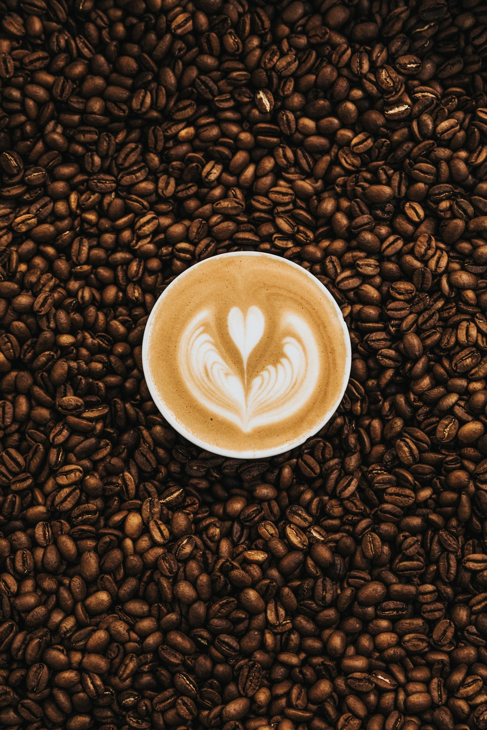 top view photography of heart latte coffee