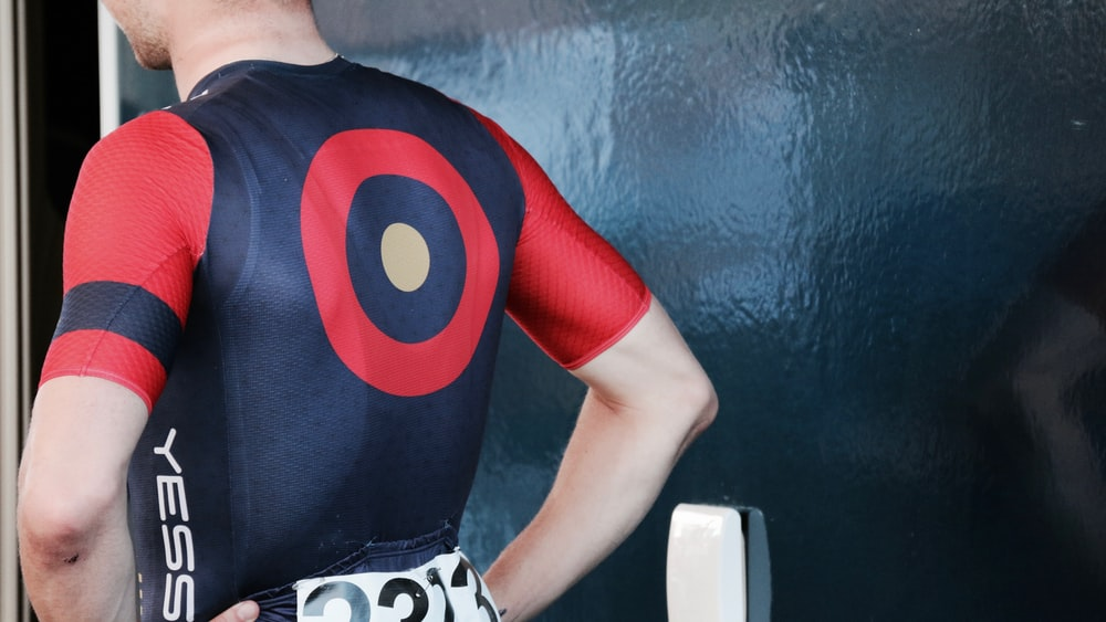 man wearing black and red cycling top