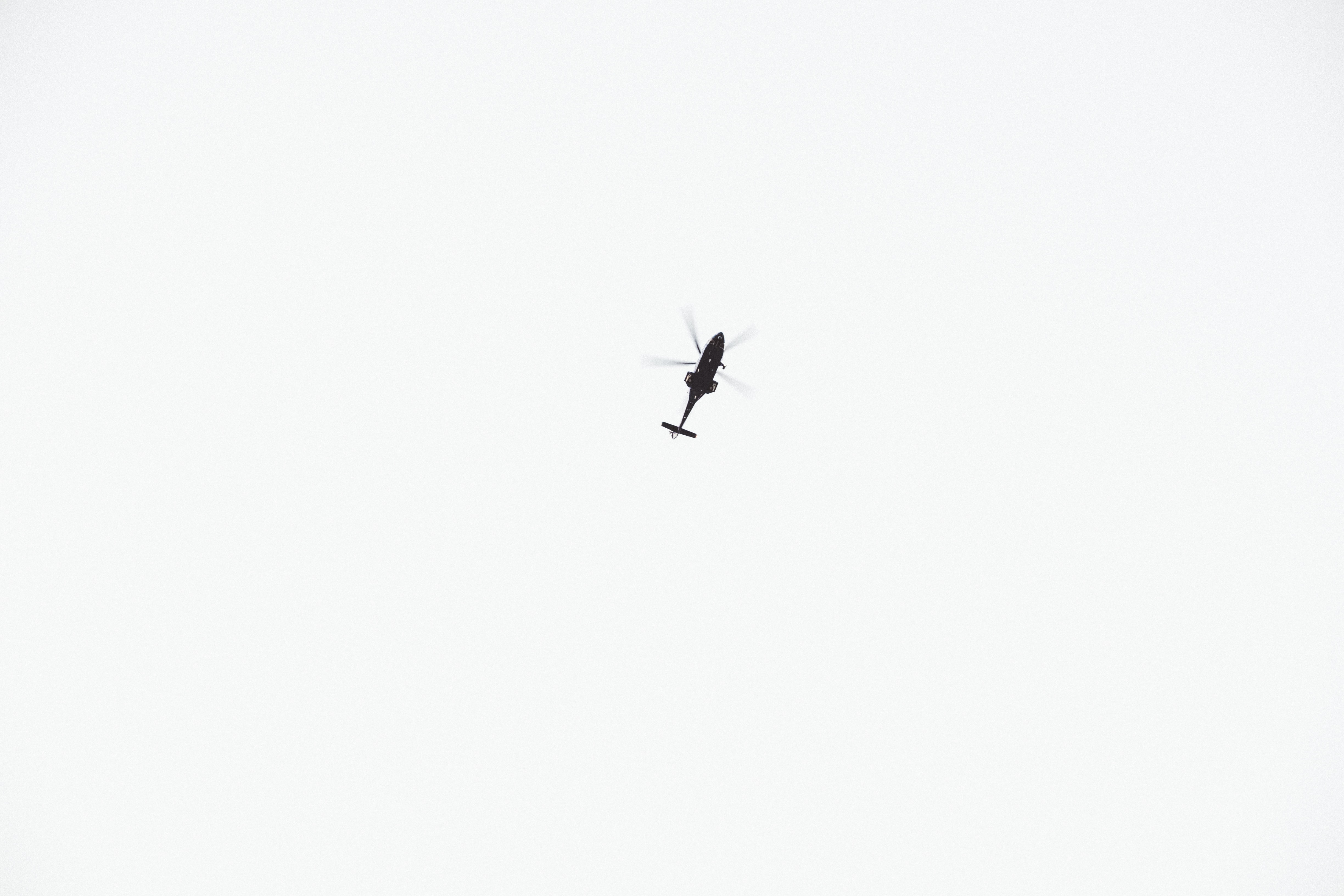 black helicopter on sky during daytime