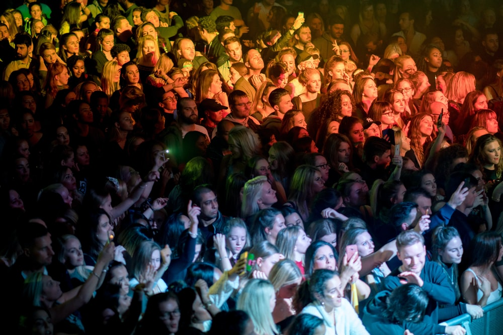 people standing near stage