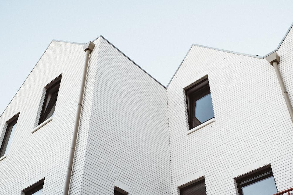 worm's eye-view of white concrete house