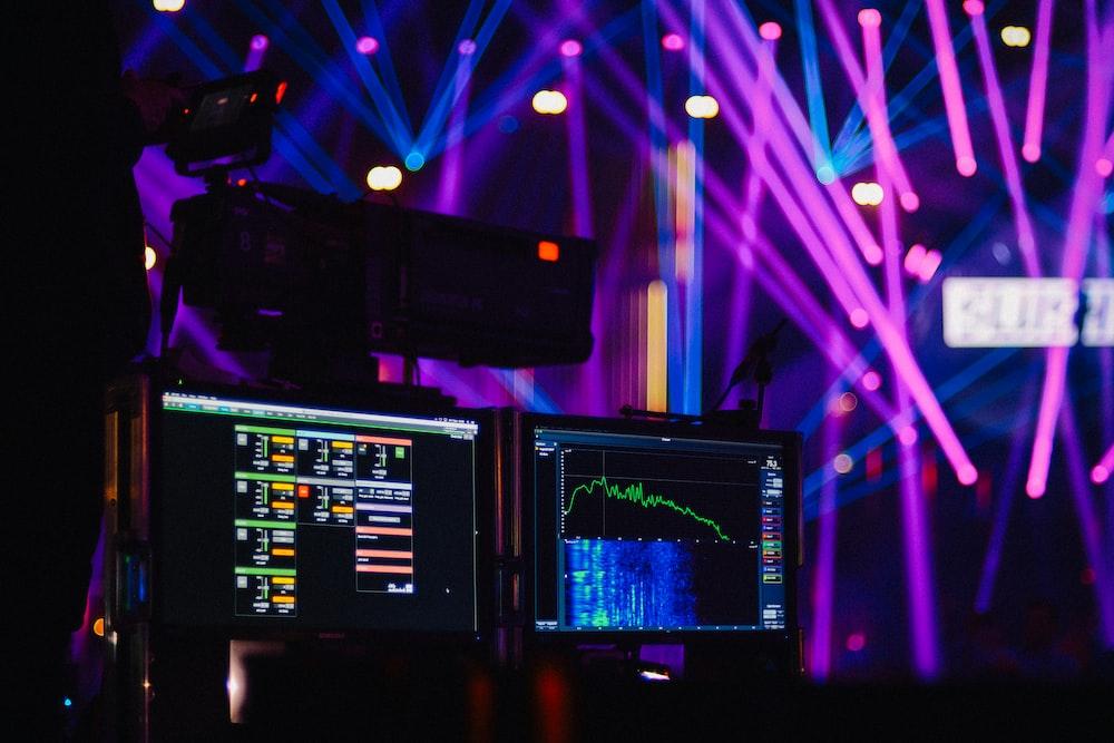 two flat screen monitors in disco room