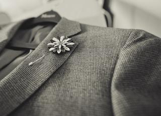 closeup photo of gray notched lapel suit jacket