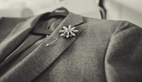closeup photo of gray notched lapel suit jacket