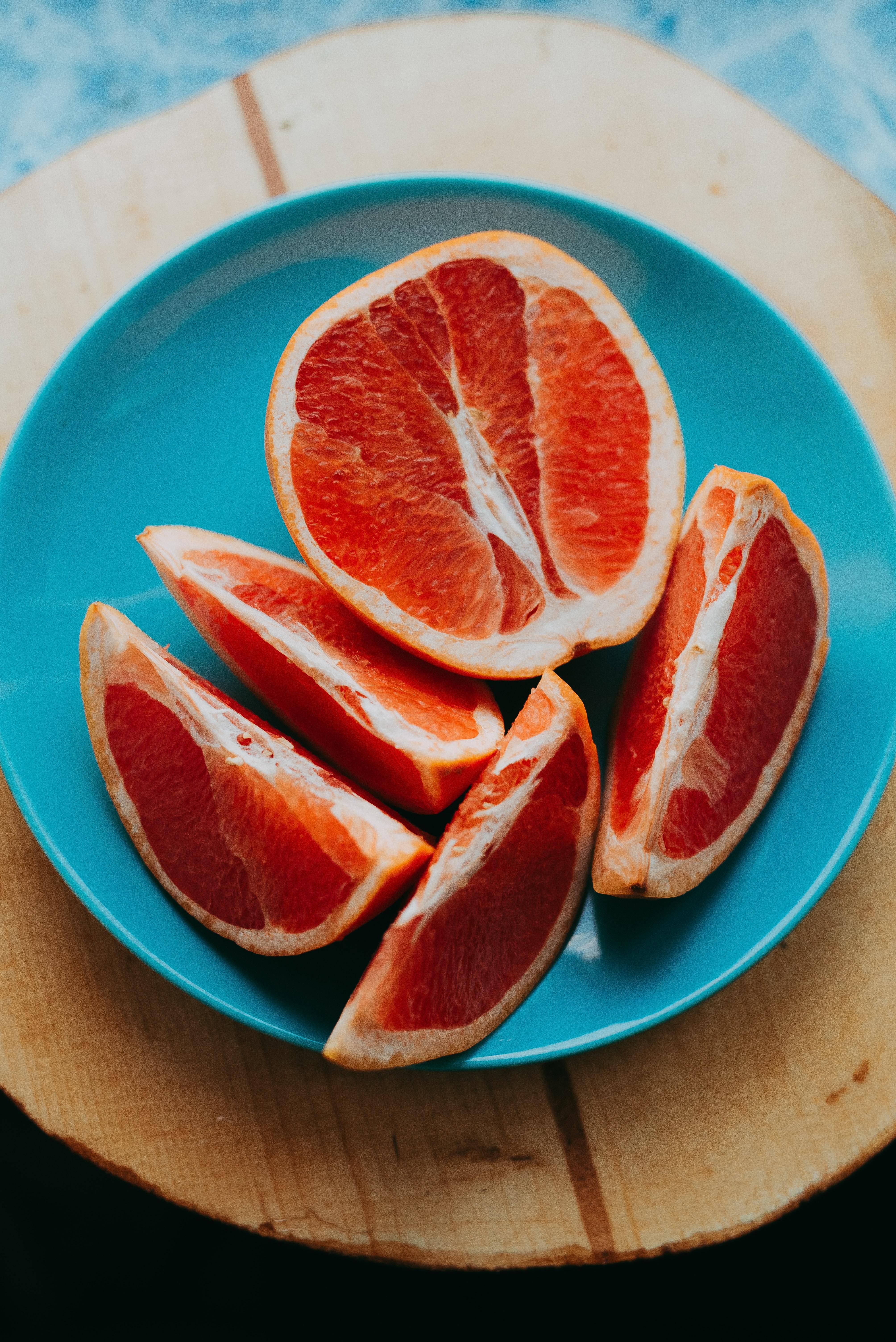 slice fruits on blue plate