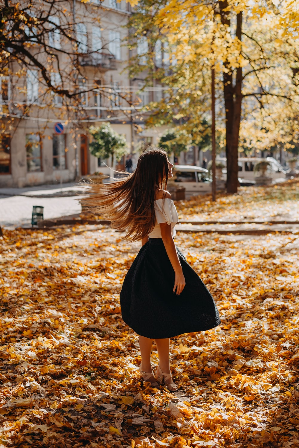 woman standing while hair waving by the wind