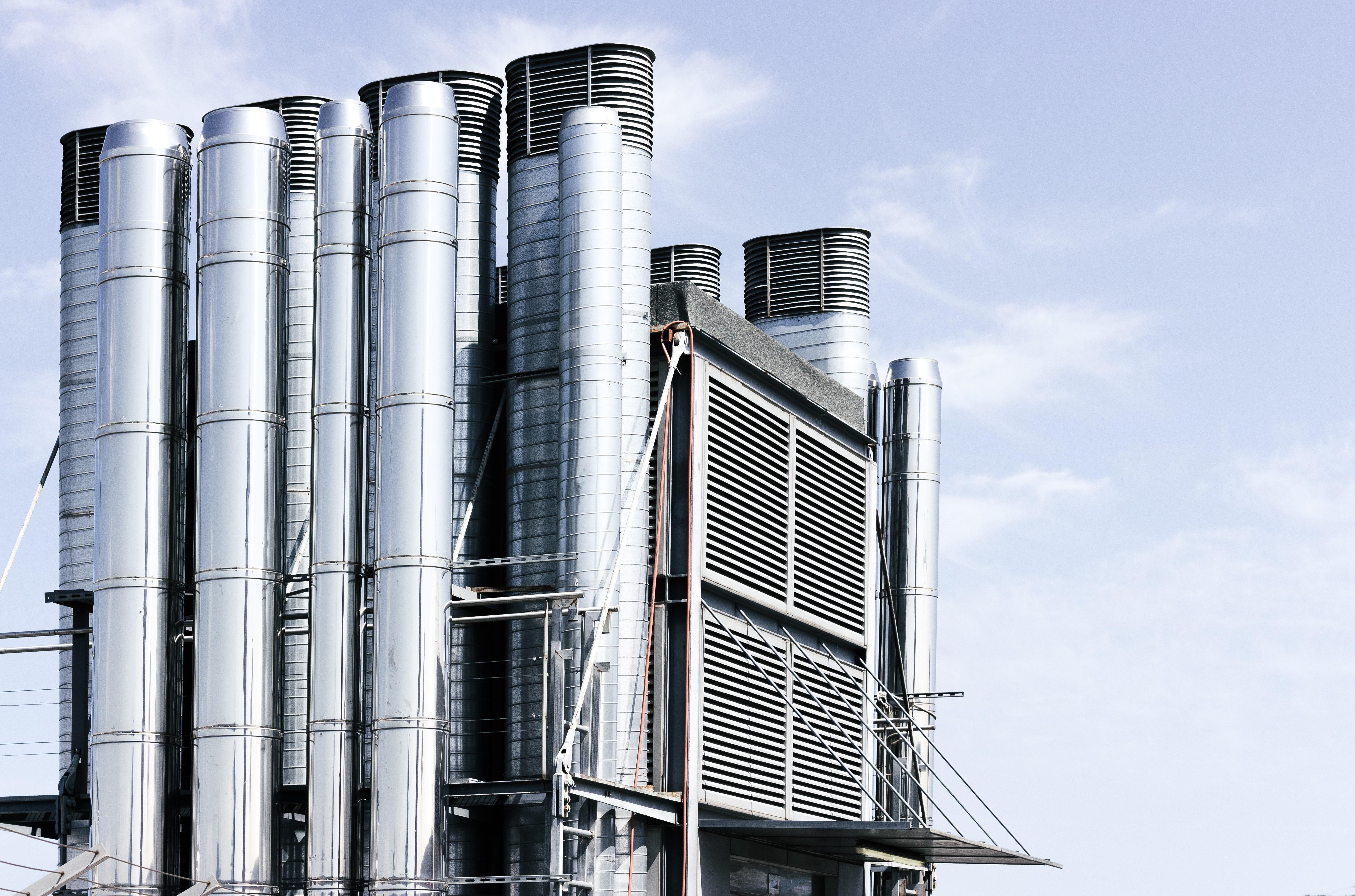photo of grey and black industrial buildings