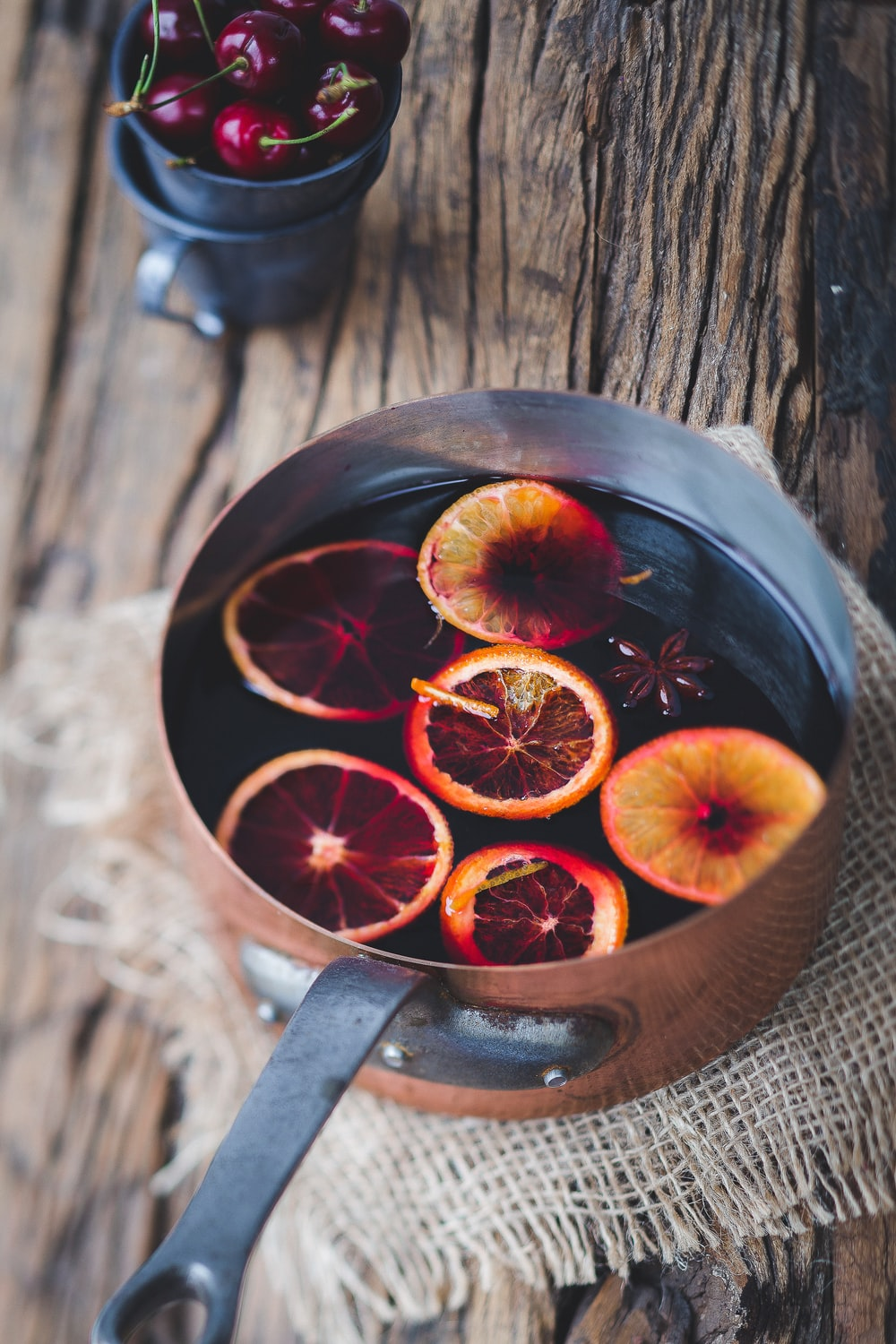 close-up photography of sliced orange fruit on brown cooking pot
