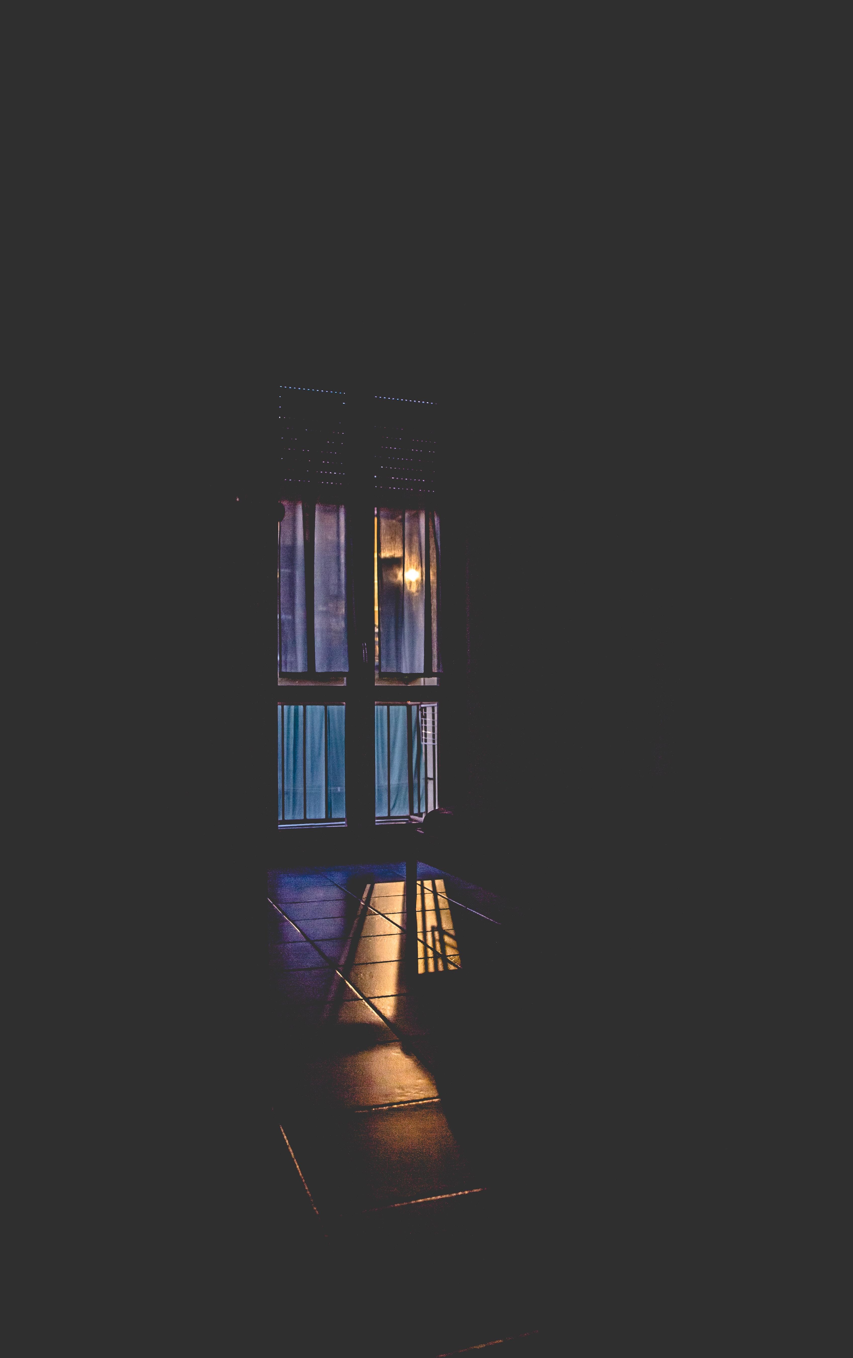 window during golden hour in dark room