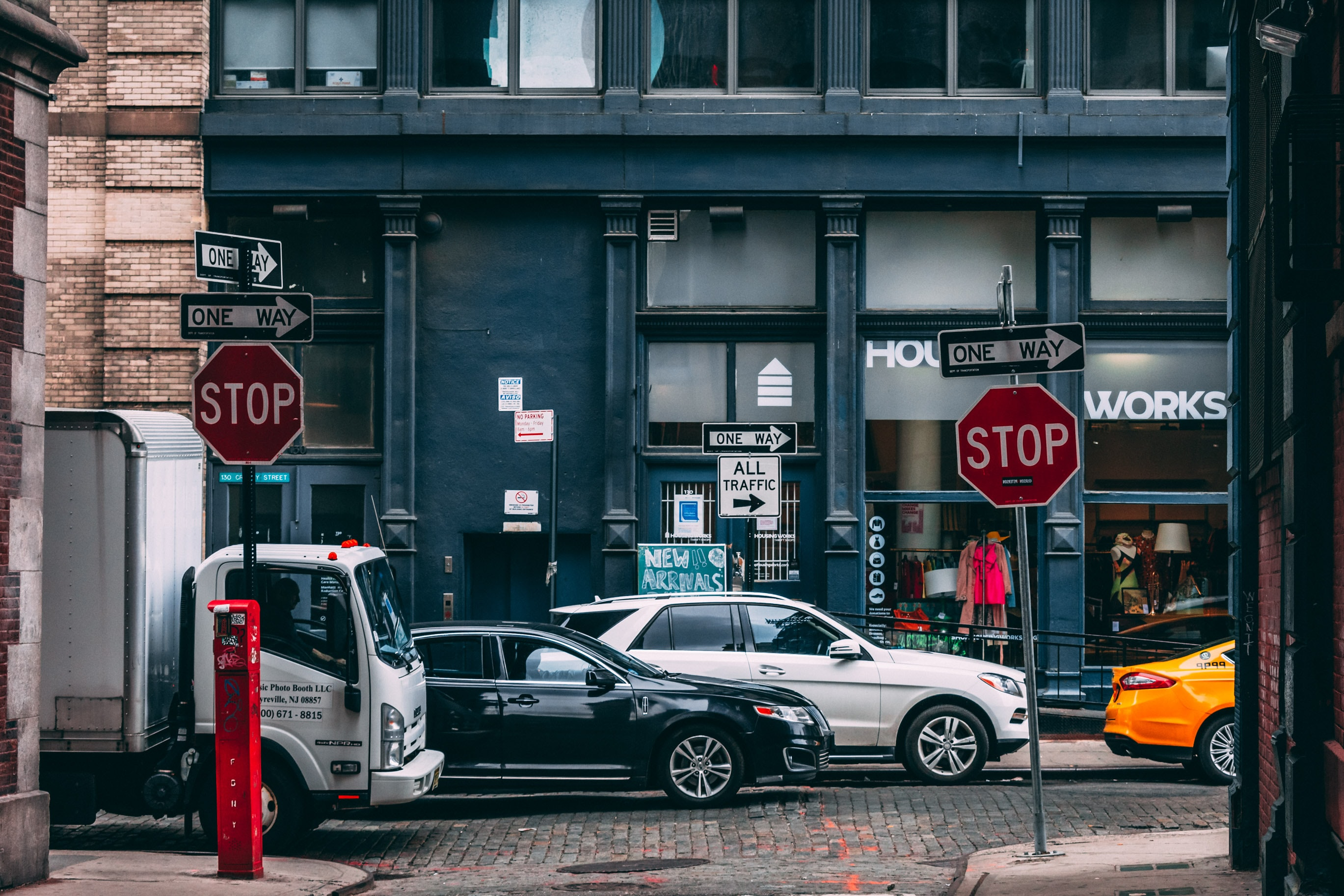 several vehicle parking near two stop signage
