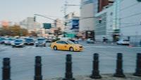 yellow car crossing