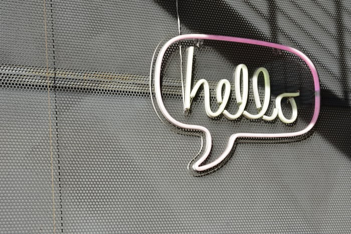 "white Hello LED sign"" by Adam Solomon on Unsplash"