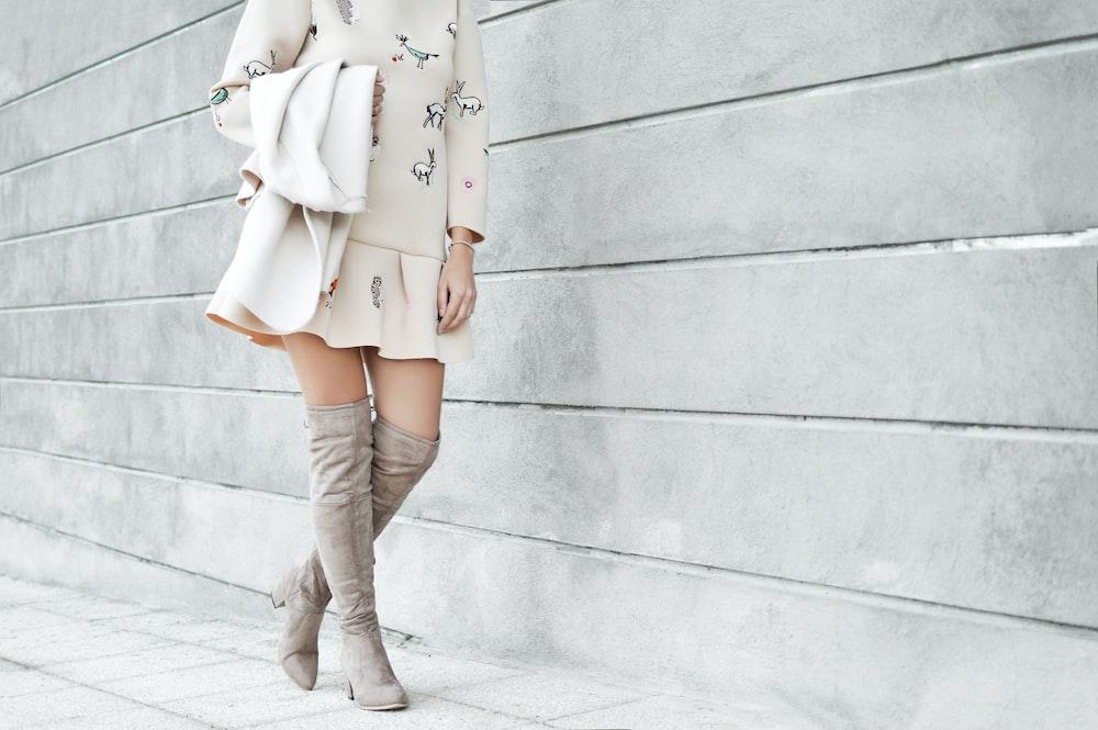woman wearing white mini dress