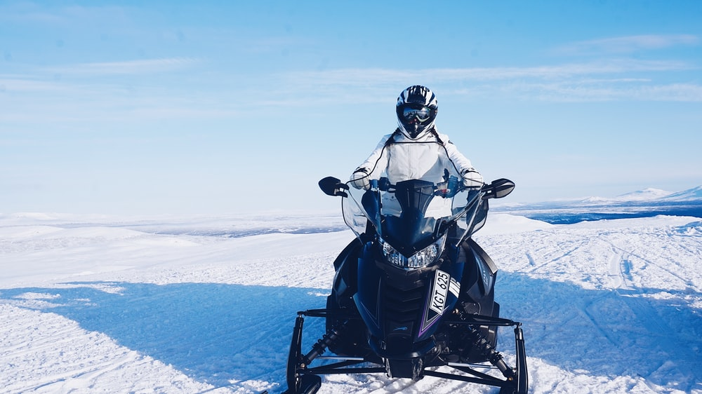 person riding on snowmobile