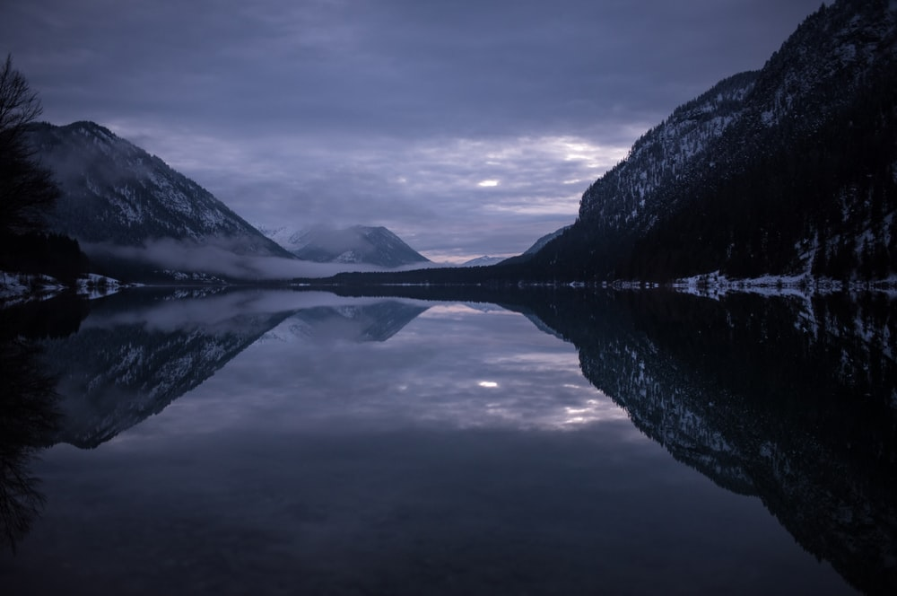 panoramic photography of body of water and mountains