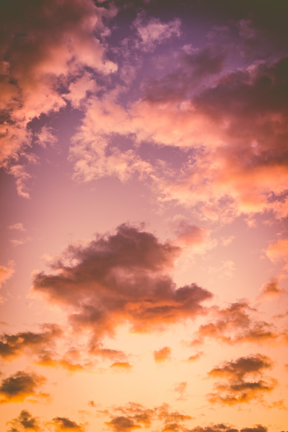 photo of cumulus clouds during golden hour
