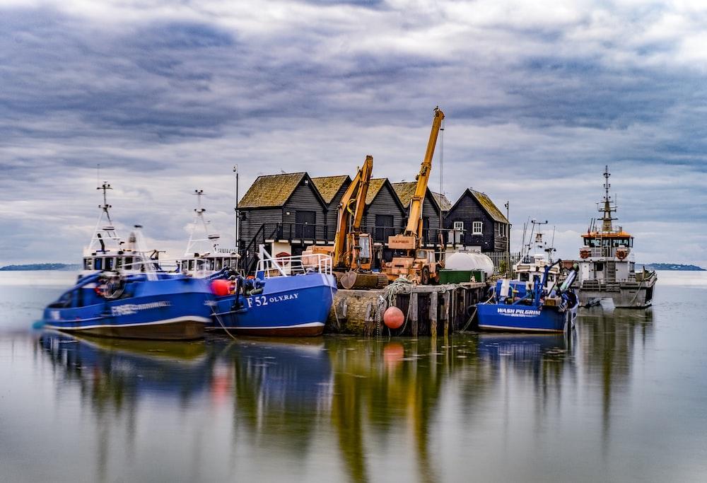 photograph of several boats near dock