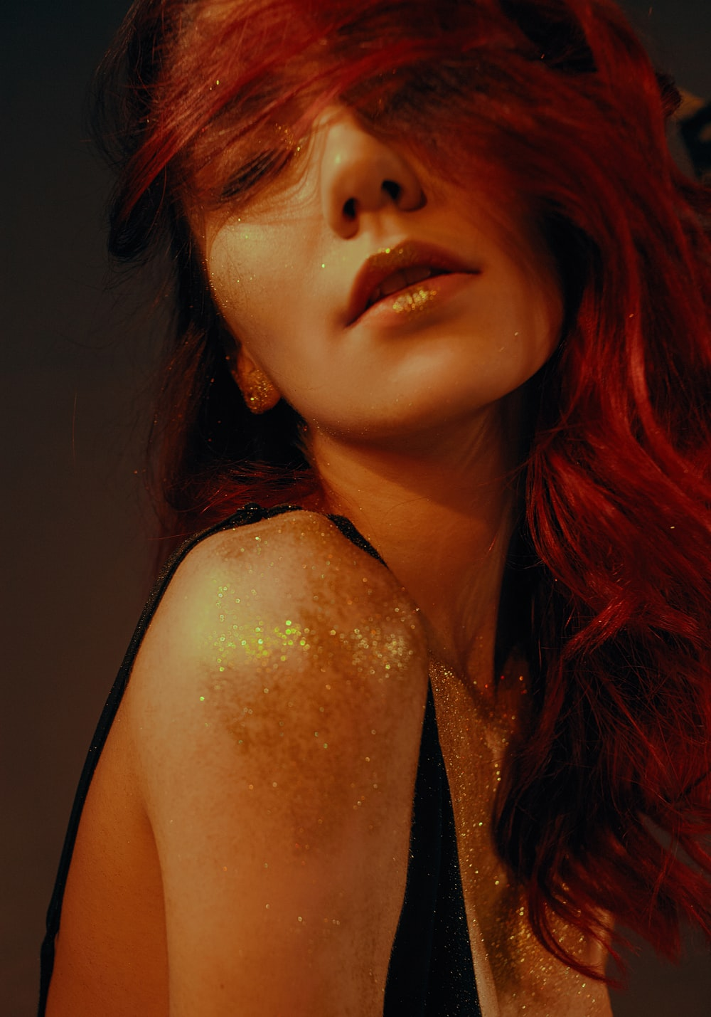 woman with glitters on her body
