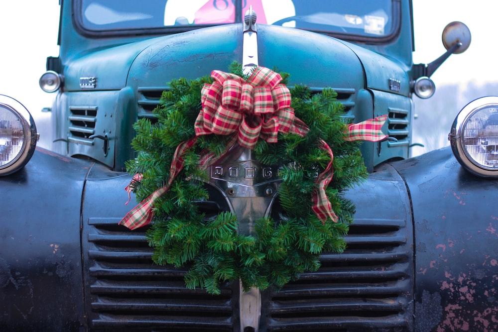 green wreath on bumper of blue truck