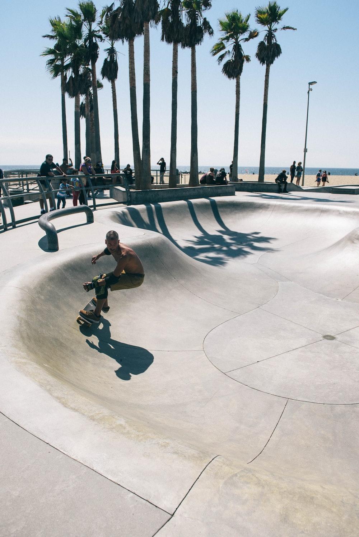 man skateboarding in skateboard track