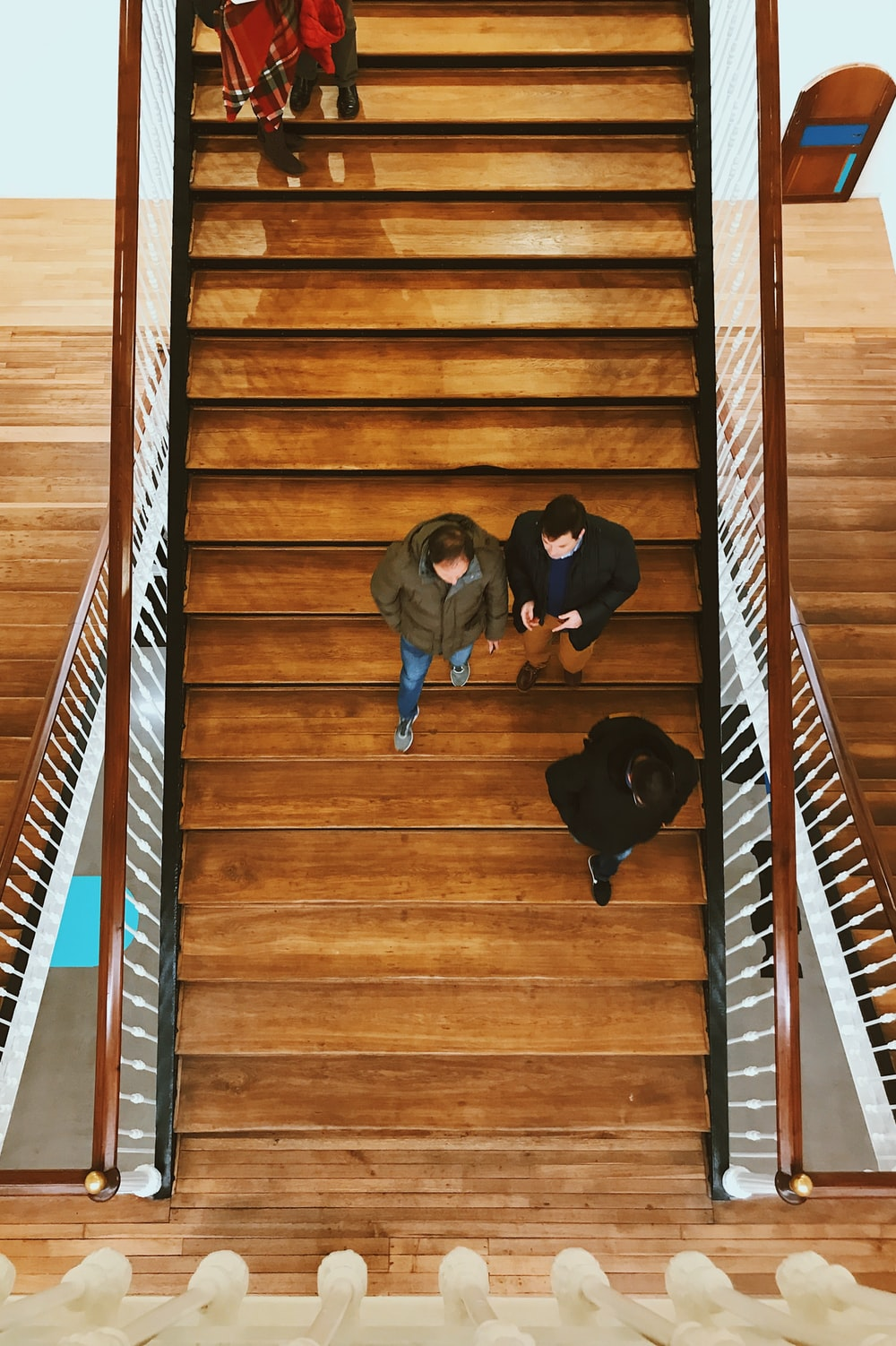 aerial photography of person walking on stair