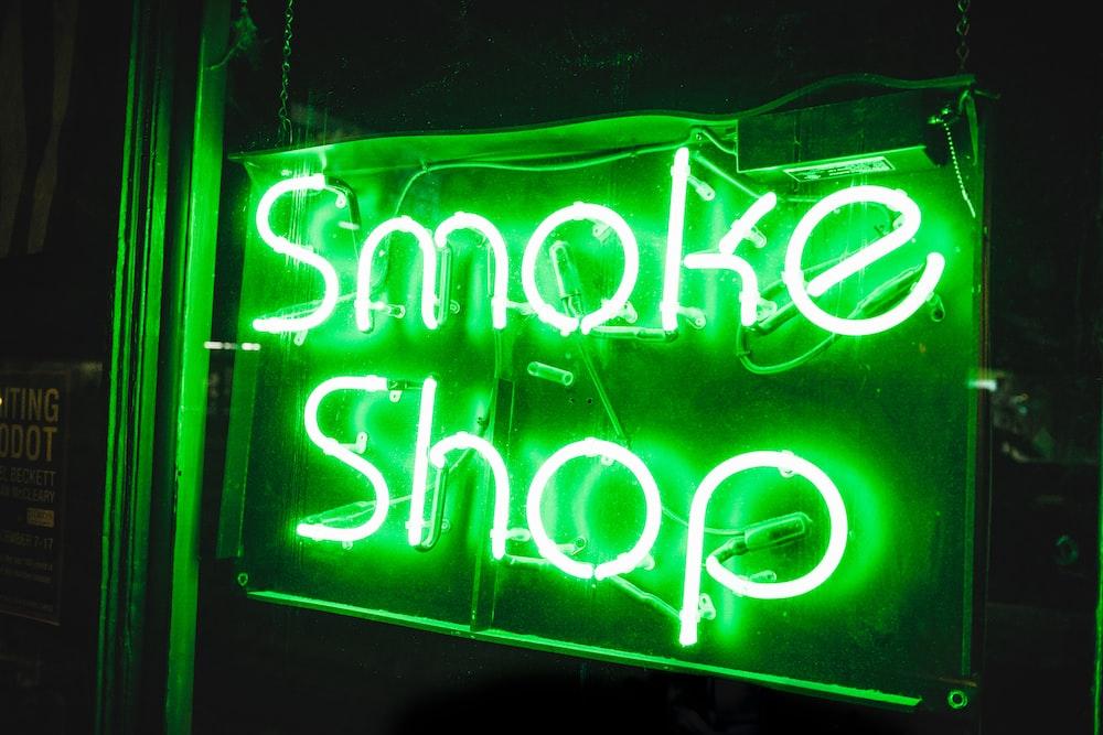 turned on smoke shop NEON signage