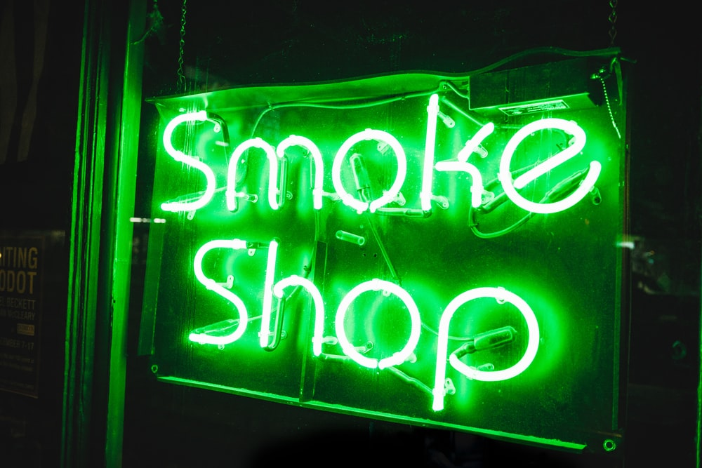 turned on smoke shop NEON signage