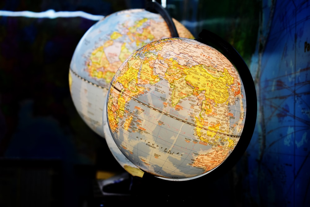shallow focus photography of two desk globe