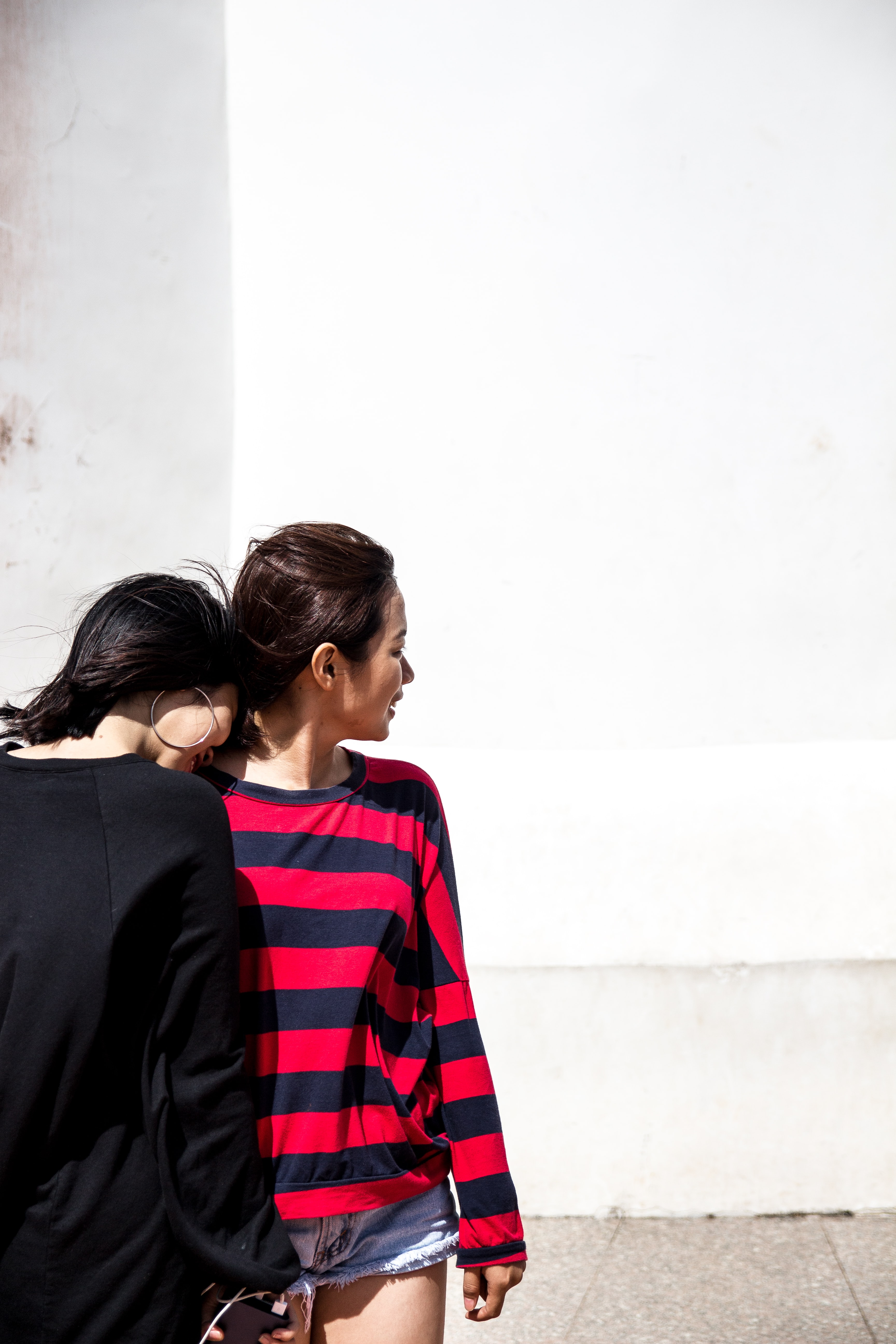 woman wearing black and red striped shirt