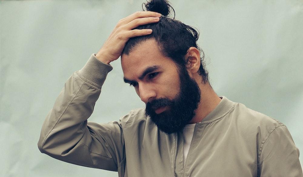 man holding his black hair