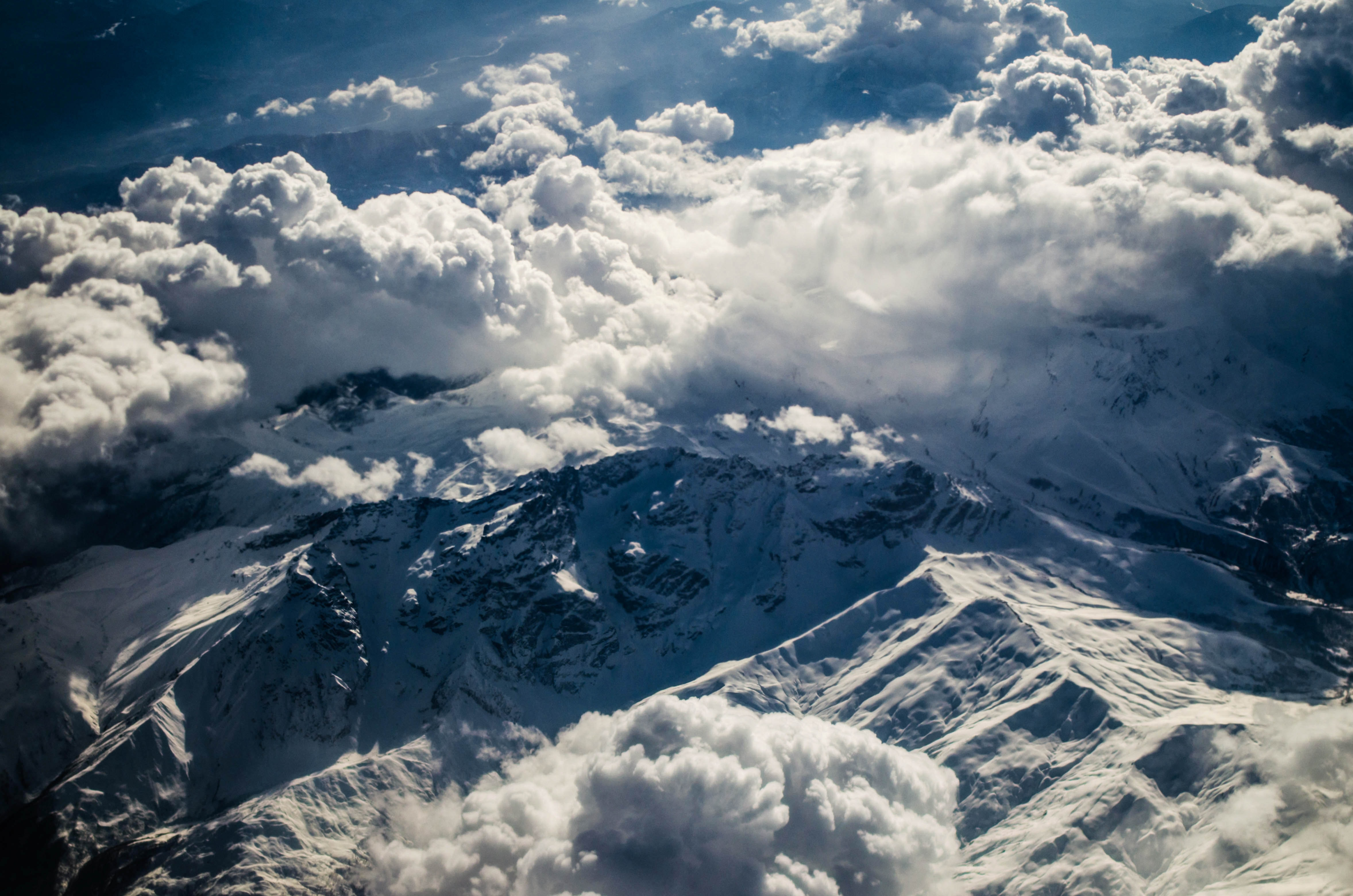 bird's eye view of mountain under clouds