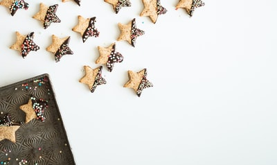 star-shape cookies with chocolate fillings gingerbread teams background