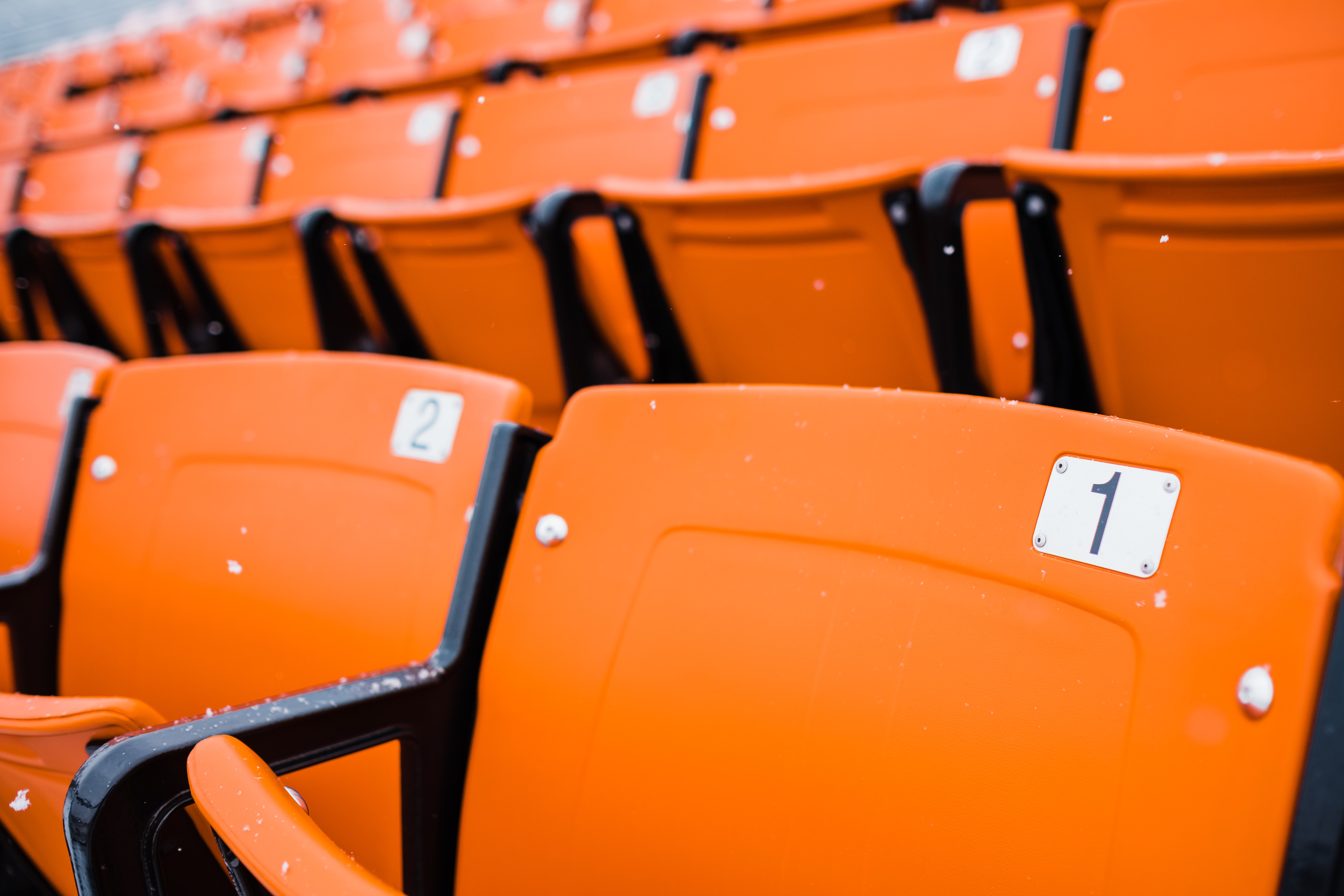 shallow focus photography of orange chairs